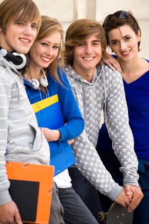 Four students standing together Stock Photo - 5644847