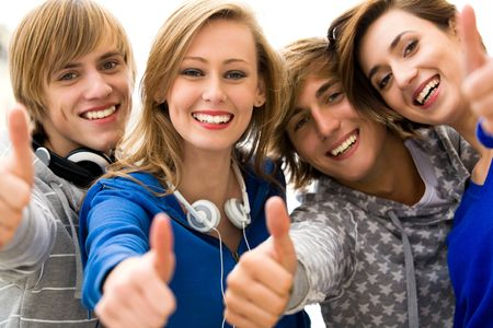 Friends showing thumbs up sign Stock Photo - 5644828