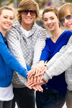 Friends putting hands together photo