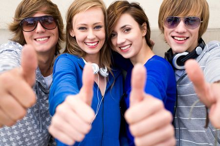 Friends with thumbs up Stock Photo - 5644855