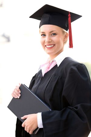 cap and gown: Female graduate smiling  Stock Photo