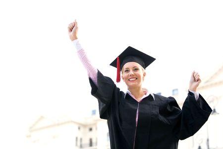 clenching: Female graduate clenching fists Stock Photo