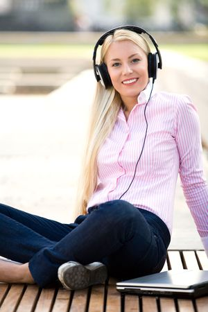 Woman with laptop and headphones photo