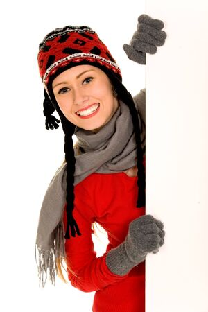 Winter girl holding blank sign photo