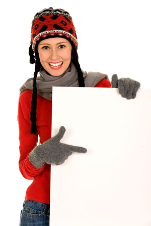 knit cap: Winter girl pointing Stock Photo