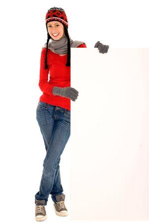 Winter girl holding blank sign photo