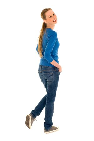 woman standing back: Young woman smiling Stock Photo