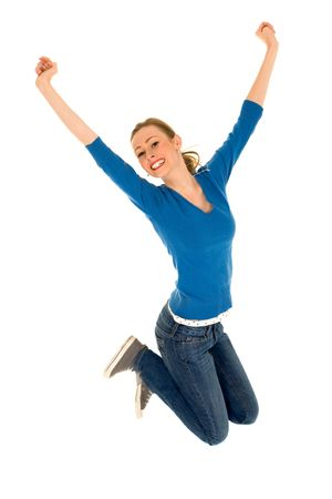 excitement: Teenager jumping with arms raised