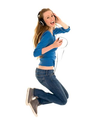 Woman Jumping with Headphones photo