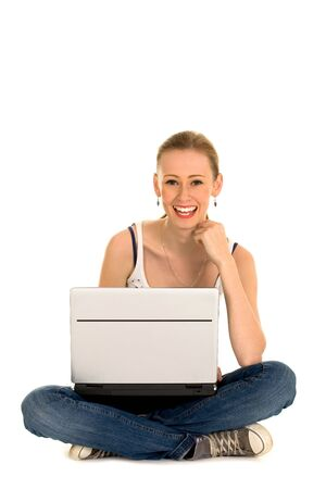 Teenage girl sitting with laptop Stock Photo - 5830645
