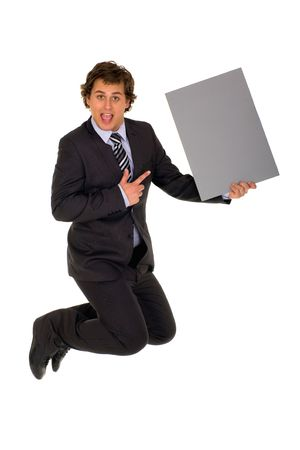 Businessman jumping with poster photo