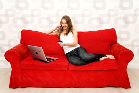 Woman sitting on couch with laptop Stock Photo - 5976254