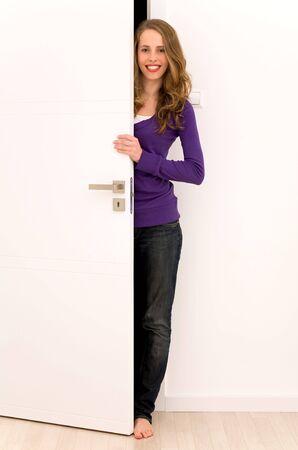 Woman opening door Stock Photo - 5976251