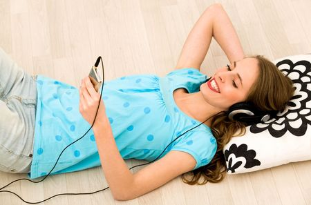 Girl listening to mp3 player photo
