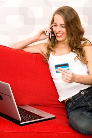 Woman using laptop, holding credit card Stock Photo - 5976261