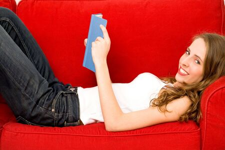 Woman reading book on couch Stock Photo - 5976268