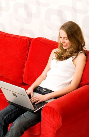 Young woman using laptop Stock Photo - 5976263