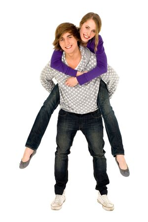 Guy giving girlfriend a piggyback ride Stock Photo - 6009384