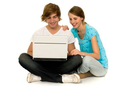 Happy couple with laptop photo
