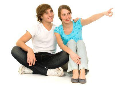 Teenage couple pointing Stock Photo - 6031974