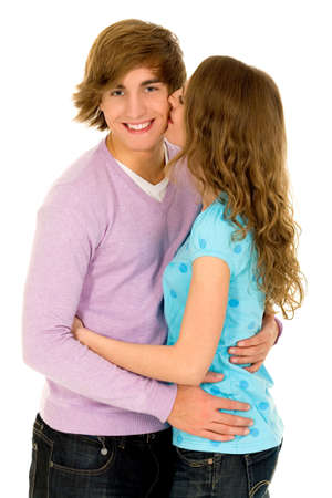 young couple hugging kissing: Happy young couple hugging Stock Photo