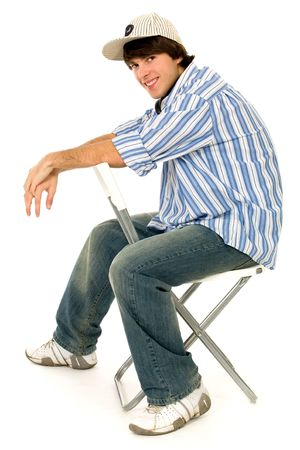 boy sitting: Young Man Sitting in Chair  Stock Photo