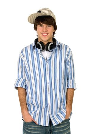 earphone: Young man with hands in pockets Stock Photo