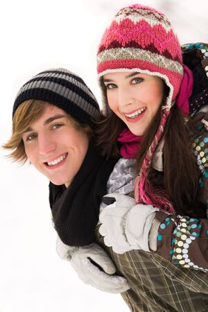 carrying girlfriend: Young couple in winter clothing Stock Photo