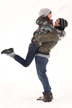 Couple playing in snow Stock Photo - 6263481