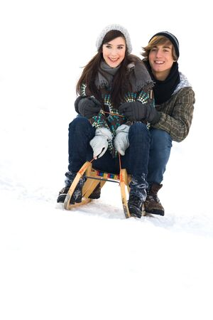 Young couple sledding Stock Photo - 6280778