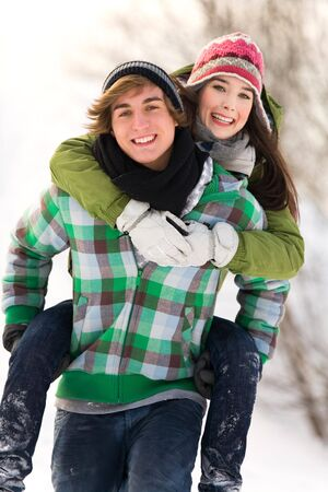 Man giving woman piggyback Stock Photo - 6280782