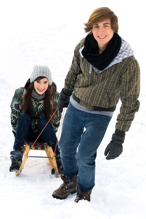 Man pulling woman on sled photo