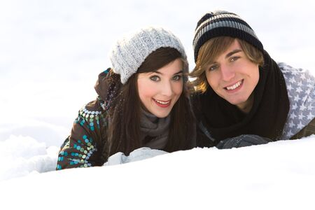 Couple lying in snow photo