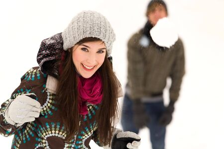 Couple having snowball fight Stock Photo - 6280036