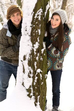Couple outdoors by tree smiling Stock Photo - 6280031