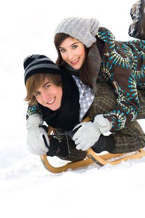 Young couple sledding photo