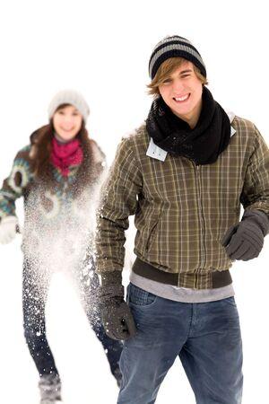 Couple having snowball fight photo