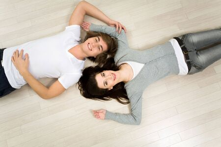 Couple lying on the floor photo