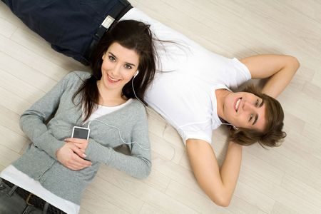 listening back: Couple lying on the floor Stock Photo
