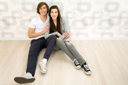 Couple sitting on the floor Stock Photo - 6342125