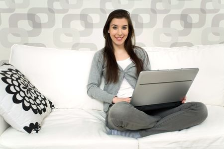 Woman on couch with laptop Stock Photo - 6446925