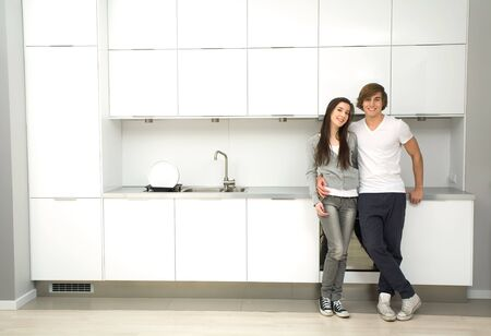 apartment house: Couple in modern kitchen