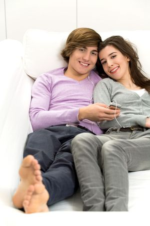 Couple resting on couch photo