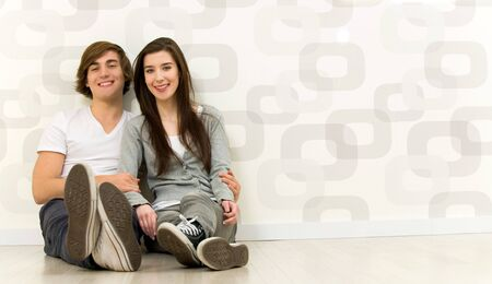 Couple sitting on the floor Stock Photo - 6389957