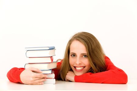 Smiling Woman with Stack of Books photo