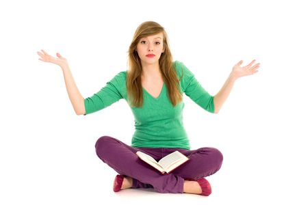 Teenager with book gesturing photo