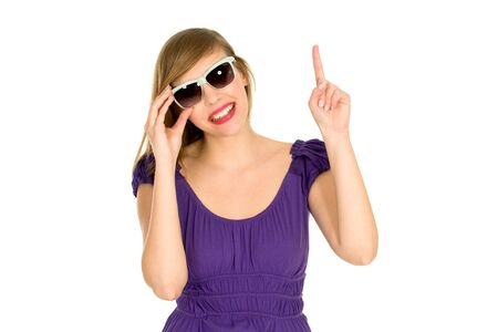Girl in sunglasses pointing Stock Photo - 6525543