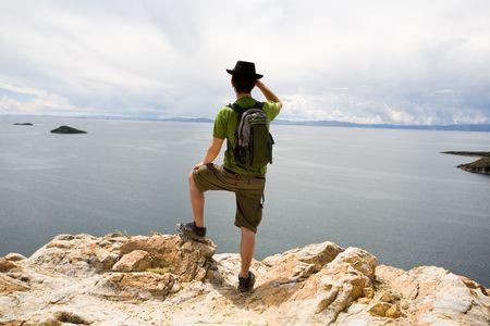 turism: Man standing on rocks, Lake Titicaca, Bolivia
