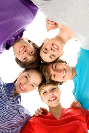 huddle: Friends in a huddle  Stock Photo
