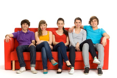 attractive couch: Friends sitting on couch